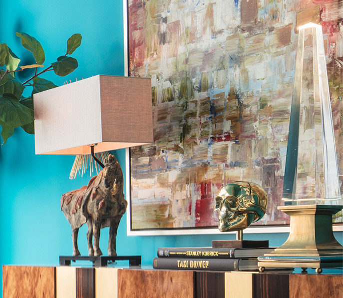 Juxtapose a modern painting with antiques-inspired elements