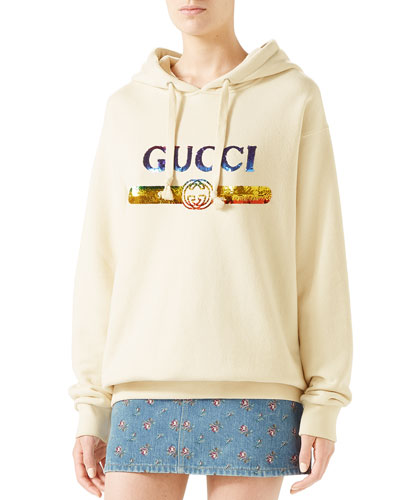 f366fa3792f Quick Look. Gucci · Sequin Logo Hooded Sweatshirt. Available in White