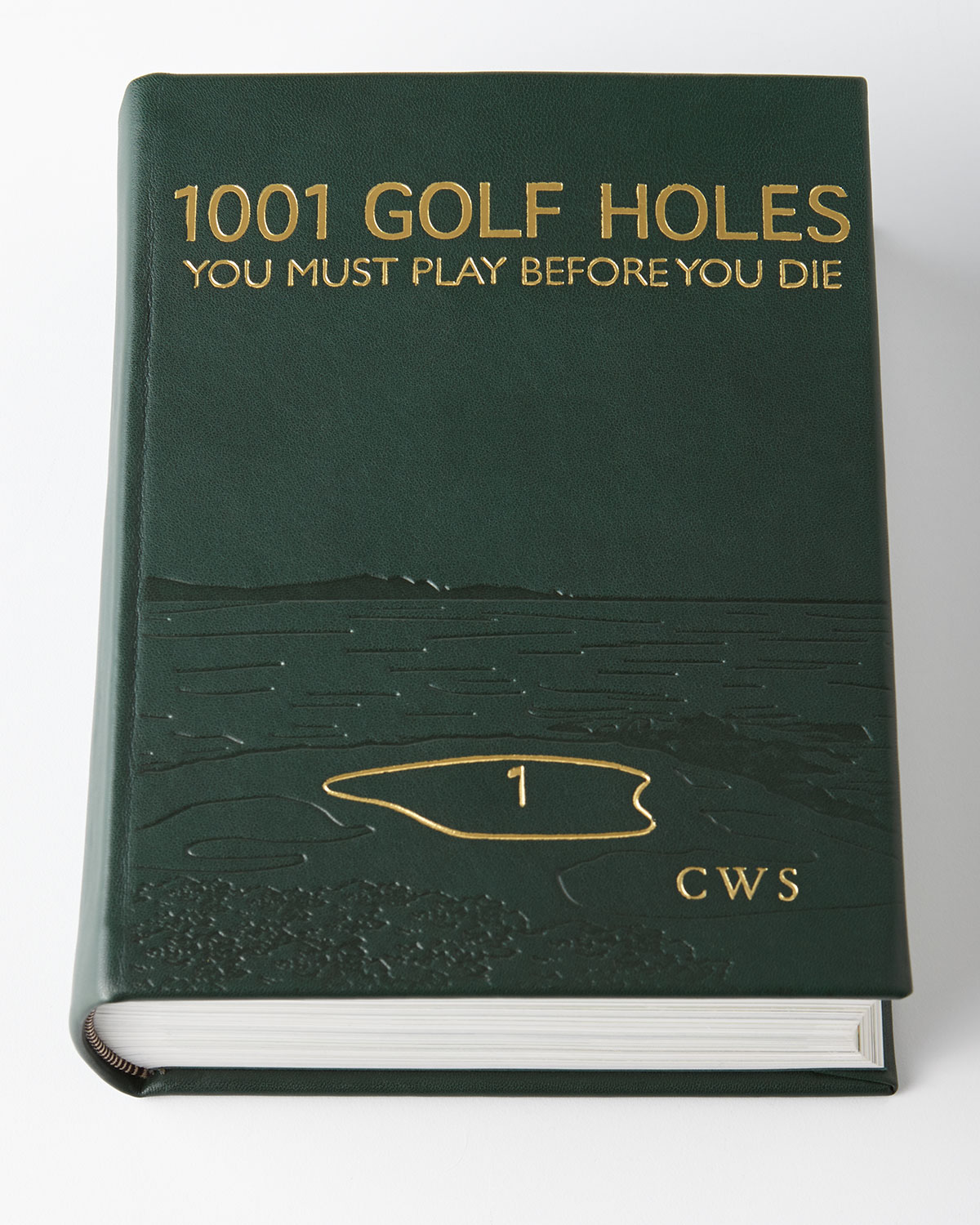 1001 Golf Holes You Must Play Before You Die encourages you to live your ultimate golfing fantasy at the world's premier courses. Gives insight into how to play the hole, the designer's intention, and the history of the greats who have played there. Features over 500 full color photographs of the most beautiful, challenging, and memorable golf holes in the world chosen by a team of international writers and golf experts. Hardcover book bound in full-grain leather. Personalization is three ini.