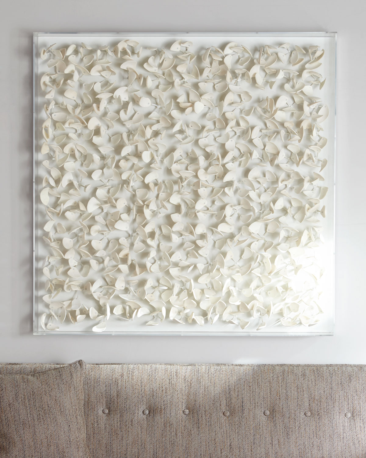"""Handcrafted wall decor. Sliced, polished coconut shell arranged in petal formations. 45.5""""Sq. x 5""""D. Acrylic frame. Imported. Weight, 50 lbs. Boxed weight, approximately 84 lbs."""