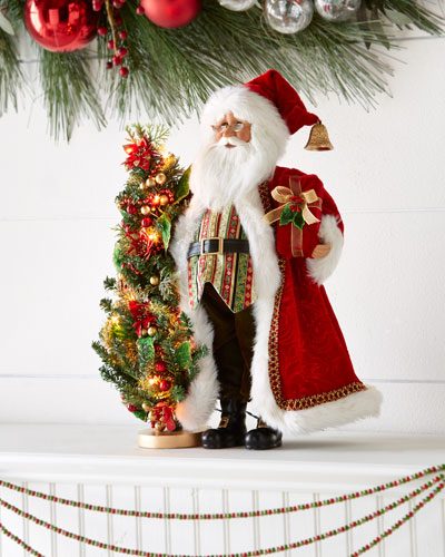 Red Santa with Lighted Tree