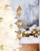 Jim Marvin 3-Tiered Gold Teardrop Christmas Ornament