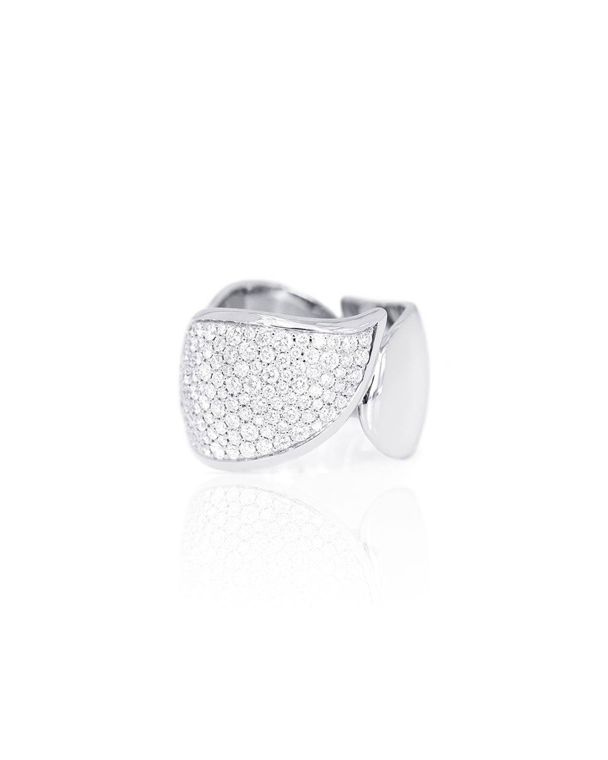 Signature Wave ring from Tamara Comolli. Polished 18-karat white gold hardware. Three drop motifs with diamond pav. Brilliant-cut F/VS white diamonds. 1.05 total diamond carat weight. Approx. 0.5\