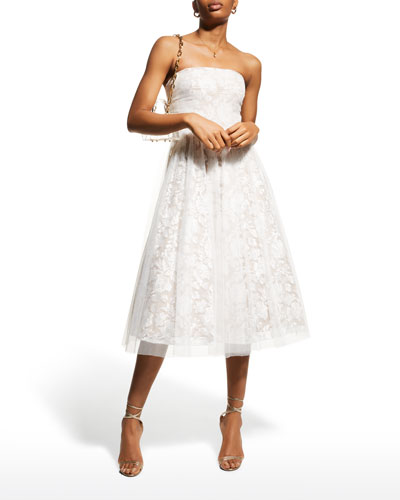 Mid-length strapless dress with smocked bodice on a 35-panel skirt in white cotton flower print with matching scarf