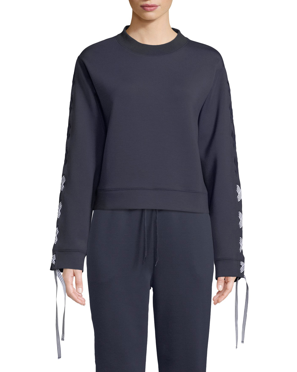 NYLORA Darcy Activewear Sweatshirt Top With Lace-Up Sleeves in Navy