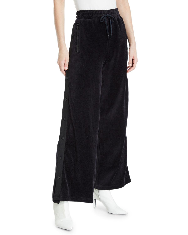 ALALA Liya Wide-Leg Velour Snap-Up Track Pants in Black