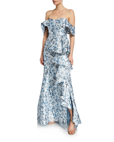 06e840c0973c Quick Look. Badgley Mischka Collection · Floral Off-the-Shoulder Short-Sleeve  Ruffle Gown. Available in Blue