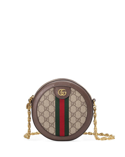4c2c16985fe Quick Look. Gucci · Ophidia Mini GG Supreme Canvas Crossbody Bag. Available  in Beige
