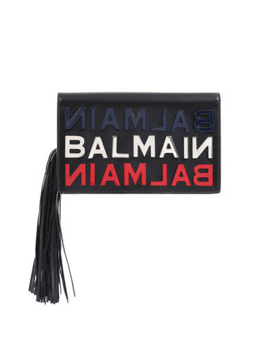 983ebeafe915 Quick Look. Balmain · Leather Logo Tasseled Clutch Bag. Available in Black