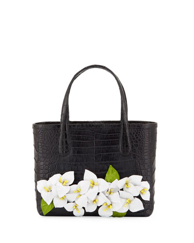 leaves with a blue interior Cotton straps of brown finish the tote bag. Cotton place mat with flowers