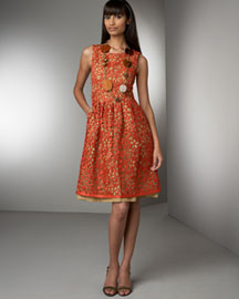 • Corded-Lace Sheath Dress: Allover persimmon (orange) floral lace with beige underlay. Scoop neckline. Sleeveless. Set-in waist. Side slash pockets. Linen; lace, polyester/rayon. Lining, pure silk.